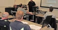 Instructor David Rogers from BC Hazmat Management Ltd. teaches a Workplace Hazardous Materials Information System (WHMIS) course to employee