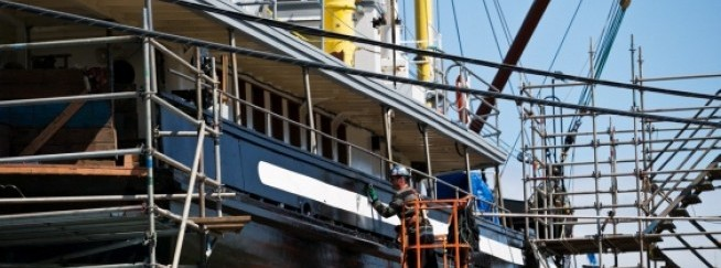 Uchuck III, a former minesweeper refitted to accommodate passengers and freight, is worked on as part of its annual facelift at Point Hope s